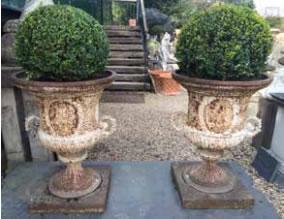 19th century cast iron urns